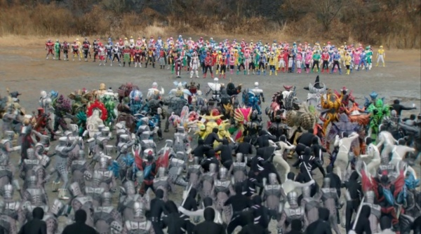 This is from the end of the film, but if you really think it's a spoiler that the Riders and Sentai eventually team up...