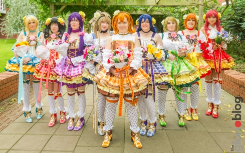 With... Hysterical Dame Cosplay as Honoka, Boo Cosplay as Rin, Lulu Rose Cosplay as Hanayo, JustPeachy Cosplay as Eli, MussonTwins Cosplay as Nozomi & Nico ,Ribbons Cosplay as Maki, Elzepel as Umi, and PopcornKuma as Kotori